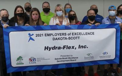 HFI employees with 2021 Dakota-Scott Employer of Excellence banner