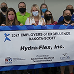 HFI employees with Employer of Excellence banner